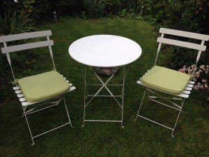 A white garden bistro cast iron table