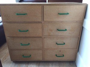 An 8-drawer Chest of Drawers with metal rails and plastic handles.