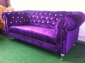 velvet upholstered Chesterfield sofa