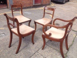 four mahogany curved base chairs