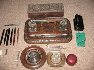 A collection of antique inkwells