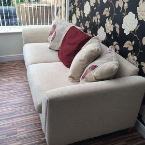 cream upholstered sofa