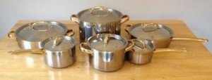 twelve stainless steel pans