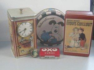 five vintage tins