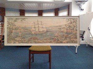 tapestry in a white frame