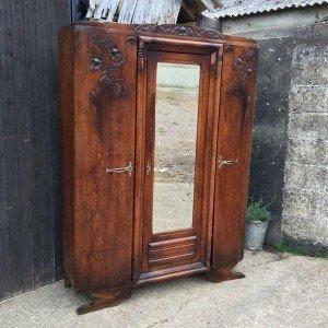 carved triple wardrobe