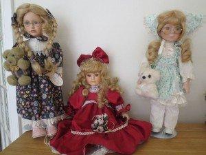three porcelain dolls