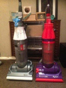 two Dyson vacuum cleaners