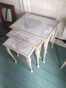 carved side tables