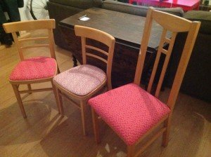three dining table chairs