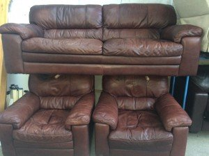 Brown leather upholstered two seater sofa