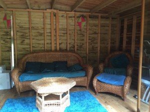 A wicker two seater sofa