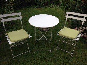 A white garden bistro cast iron table