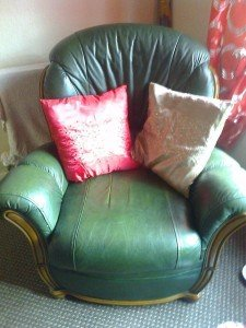Green leather 3 piece suite.