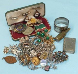 Two silver charm bracelets, a Women's Voluntary Service Medal, an RAOB silver medal, costume jewellery and other items.