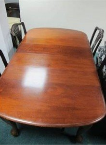 A five piece Mahogany dining suite