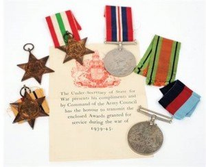 A World War II group of five medals: 1939-45 War Medal, Defence Medal, Africa Star, Italy Star and 1939-45 Star in official card box.