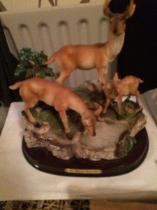 figurine of a stag family