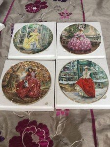 four Royal Doulton wall plates