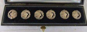 six silver Art Nouveau style buttons