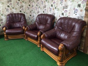 three vintage armchairs