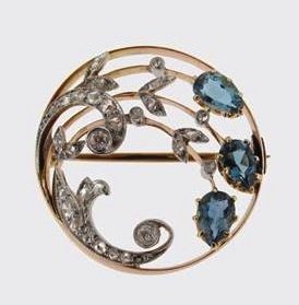 gold circular brooch