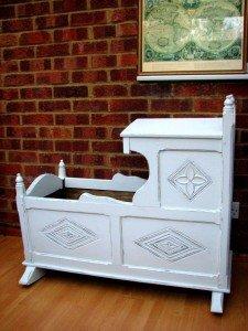 carved rocking crib
