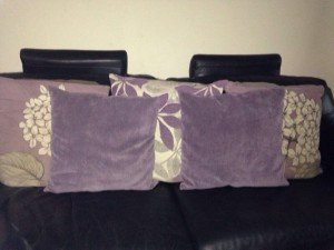 five lilac sofa cushions